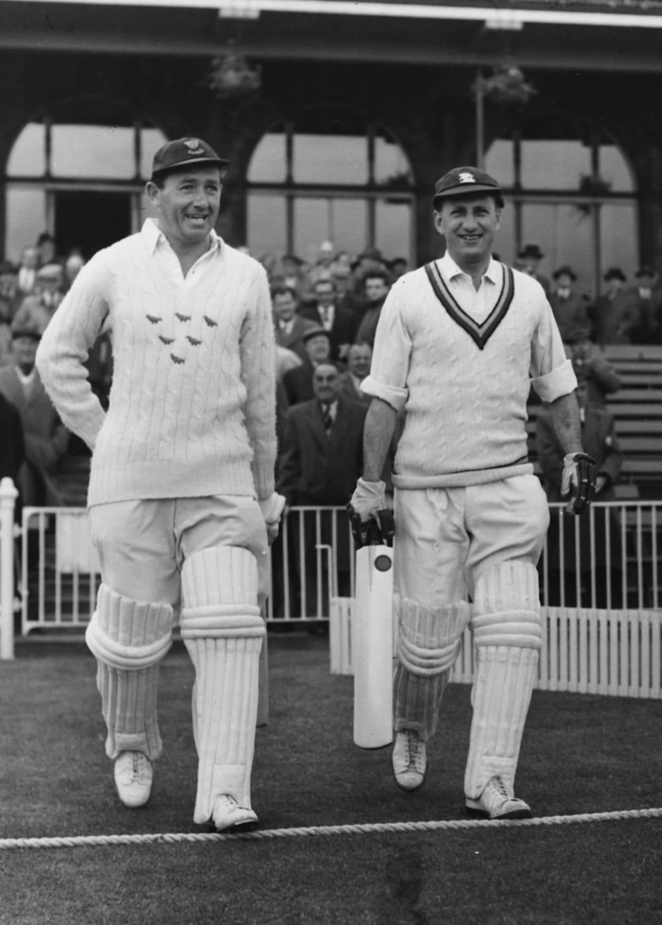 Smith, left, leaves the pavilion with Sir Len Hutton to open the innings for MCC against Lancashire in 1957 - Paul Popper/Popperfoto
