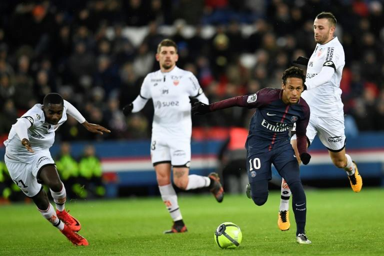 Paris Saint-Germain's forward Neymar (R) makes his way through the defence during the French L1 football match against Dijon January 17, 2018