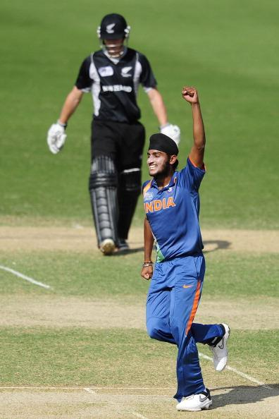 TOWNSVILLE, AUSTRALIA - AUGUST 23:  Harmeet Singh of India celebrates the wicket of Will Young of New Zealand during the ICC U19 Cricket World Cup 2012 Semi Final match between India and New Zealand at Tony Ireland Stadium on August 23, 2012 in Townsville, Australia.  (Photo by Ian Hitchcock/Getty Images)