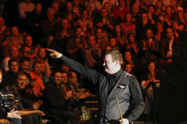 Shaun Murphy of England gestures to the audience at the start of the final of the BGC masters snooker tournament verses Australia's Neil Robertson at Alexandra Palace in London, on January 22, 2012. AFP PHOTO / JUSTIN TALLIS (Photo credit should read JUSTIN TALLIS/AFP/Getty Images)