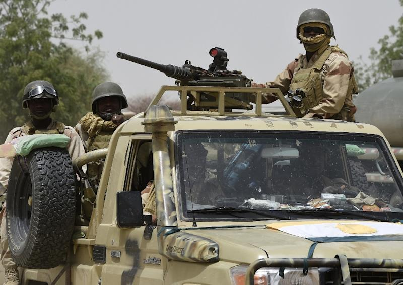 Niger troops patrol near Malam Fatori on April 3, 2015, after the town in north-eastern Nigeria was retaken from Boko Haram by troops from Chad and Niger