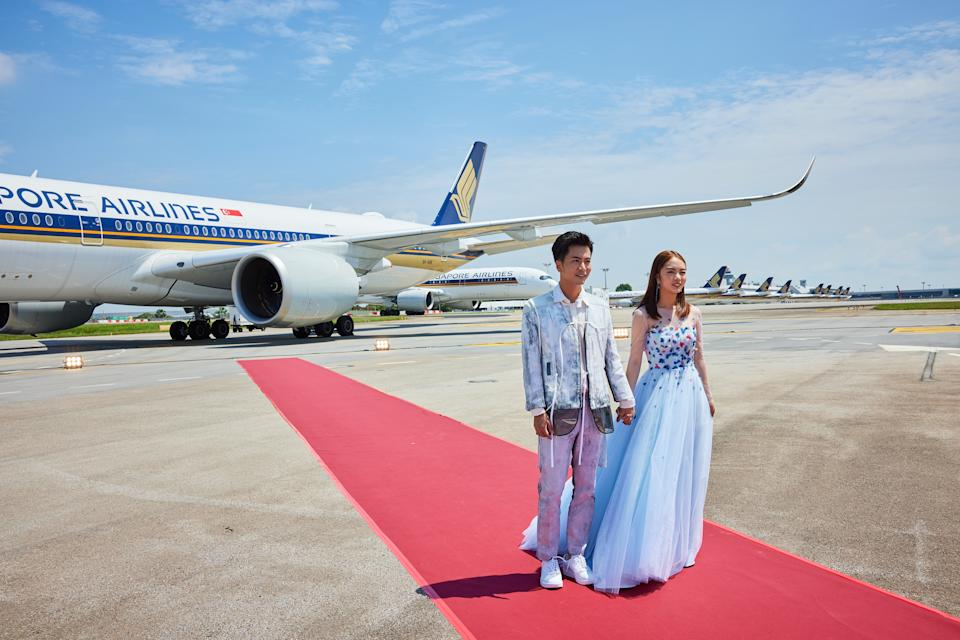 Xu Bin and his wife Evelyn Wang Yifei in a shoot prior to Star Awards held at Changi Airport on 18 April 2021. (Photo: Mediacorp)