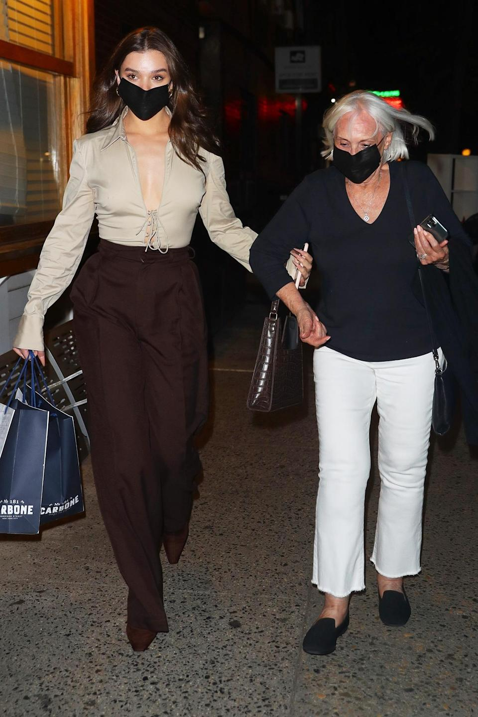 <p>Hailee Steinfeld walks arm-in-arm with her grandmother after grabbing dinner together at Carbone in N.Y.C. on Sept. 14. </p>