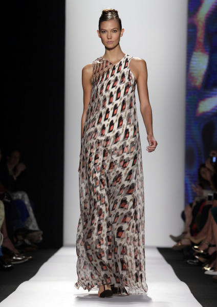 Karlie Kloss models an outfit from The Carolina Herrera Spring 2014 collection during Fashion Week in New York, Monday, Sept. 9, 2013. (AP Photo/Richard Drew)
