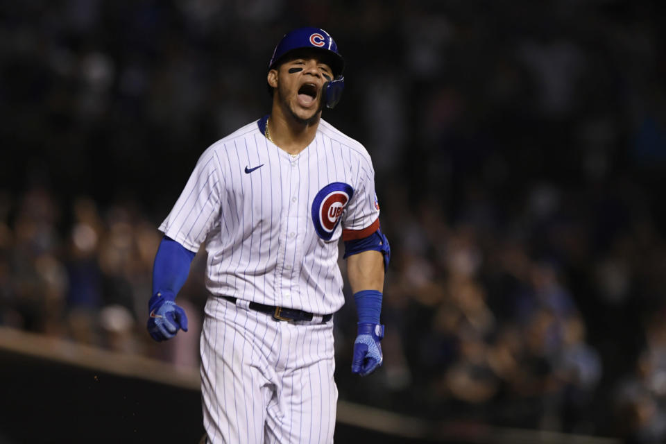 Chicago Cubs' Willson Contreras celebrates at third base after hitting a solo home run during the eighth inning of a baseball game against the Cincinnati Reds, Monday, July 26, 2021, in Chicago. (AP Photo/Paul Beaty)