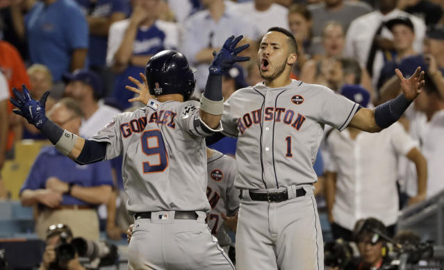 Astros' left fielder Marwin Gonzalez celebrates his game-tying home run in the ninth inning of World Series Game 2. (AP)