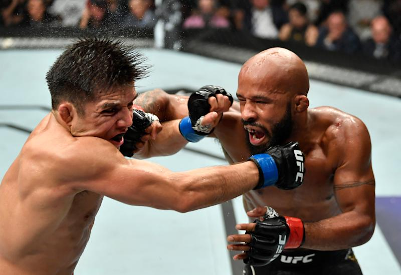 LOS ANGELES, CA - AUGUST 04: (R-L) Demetrious Johnson punches Henry Cejudo in their UFC flyweight championship fight during the UFC 227 event inside Staples Center on August 4, 2018 in Los Angeles, California. (Photo by Jeff Bottari/Zuffa LLC/Zuffa LLC via Getty Images)