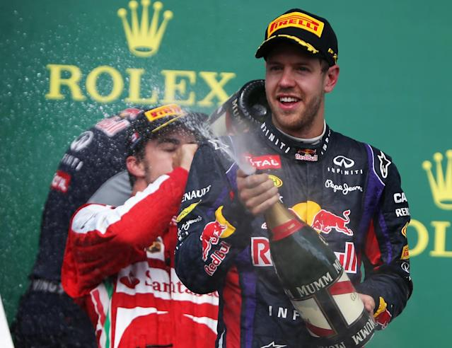 MONTREAL, QC - JUNE 09: Sebastian Vettel of Germany and Infiniti Red Bull Racing celebrates on the podium after winning the Canadian Formula One Grand Prix at the Circuit Gilles Villeneuve on June 9, 2013 in Montreal, Canada. (Photo by Mark Thompson/Getty Images)
