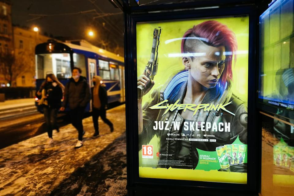 City light poster advertising video game Cyberpunk 2077 is now on stores December 10, 2020 in Krakow, Poland. A worldwide premiere of the game developed and published by CD Projekt Red took place on December 10, 2020. (Photo by Beata Zawrzel/NurPhoto via Getty Images)