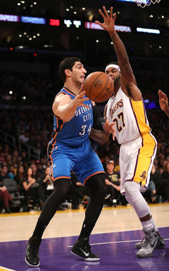 LOS ANGELES, CA - MARCH 01: Enes Kanter #34 of the Oklahoma City Thunder throws a pass around Jordan Hill #27 f the Los Angeles Lakers at Staples Center on March 1, 2015 in Los Angeles, California. NOTE TO USER: User expressly acknowledges and agrees that, by downloading and or using this photograph, User is consenting to the terms and conditions of the Getty Images License Agreement. (Photo by Stephen Dunn/Getty Images)