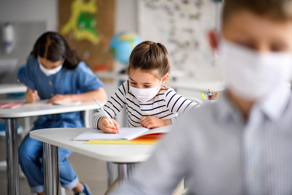 The CDC updated its guidelines on schools reopening Friday, suggesting that three feet — instead of six — may be enough to curb the spread of COVID-19. (Photo: Getty Images)