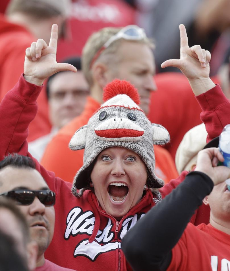 A Utah fan cheers during the first quarter of an NCAA college football game against Stanford on Saturday, Oct. 12, 2013, in Salt Lake City. Utah won 27-21. (AP Photo/Rick Bowmer)