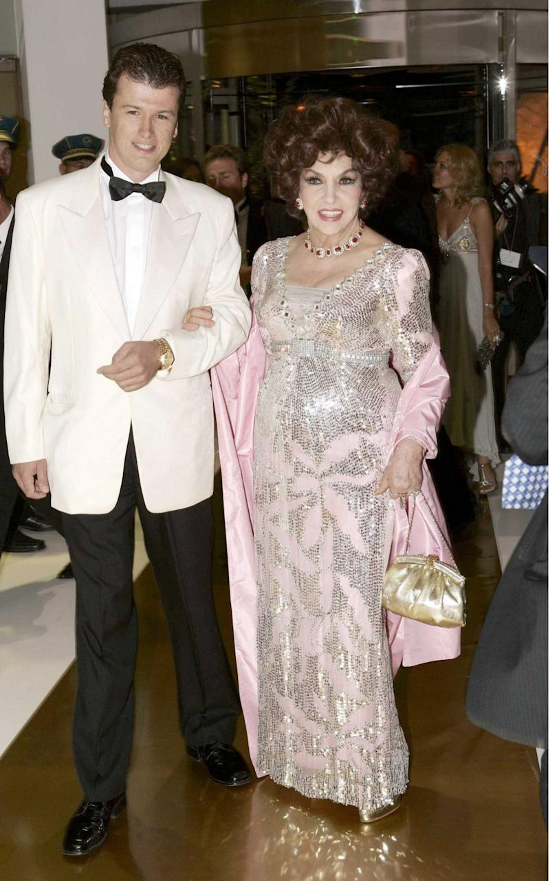 Gina Lollobrigida and her then boyfriend, Javier Rigau, at a Red Cross ball in Monte Carlo in 2005 - Credit: Rex