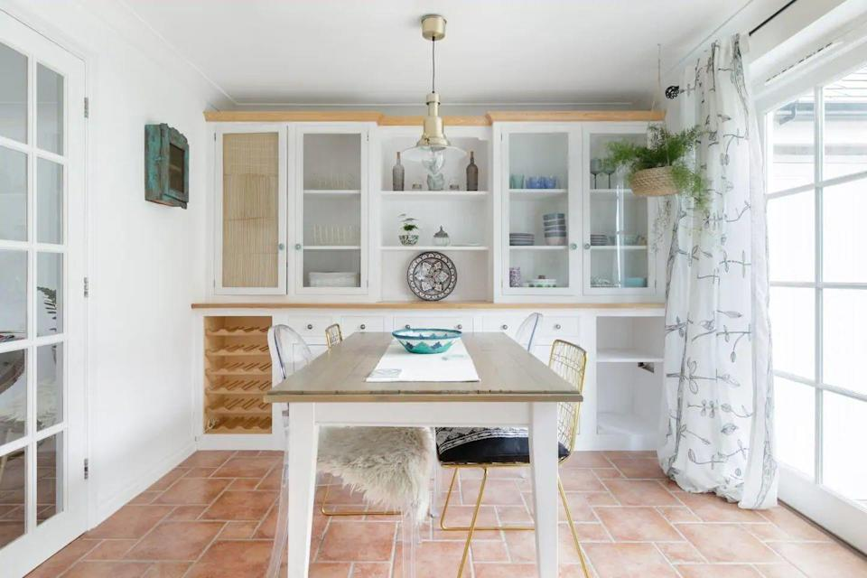 """<p>This lovely and bright Airbnb in Cornwall sits in the pretty village of Charlestown, where Poldark and Hollywood movies have been filmed. While it's thoroughly Cornish, there's a Mediterranean feel about the holiday cottage.</p><p>You'll find tiled floors, white walls throughout and elegant pops of green and pastel hues. The Airbnb is ideal for small families, with its location close to the Eden Project, plus the host has been praised for adding a high chair and a gate to the stairs for guests who bring little ones.</p><p><strong>Sleeps</strong>: 4</p><p><strong>Price per night:</strong> £120</p><p><strong>Why we love it: </strong>The light interiors delightful outdoor space make it ideal for summer staycations.</p><p><a class=""""link rapid-noclick-resp"""" href=""""https://www.airbnb.co.uk/rooms/plus/27805251?source_impression_id=p3_1592808764_t%2B2%2FBbEak8bAgizo&guests=1&adults=1"""" rel=""""nofollow noopener"""" target=""""_blank"""" data-ylk=""""slk:SEE INSIDE"""">SEE INSIDE</a></p>"""
