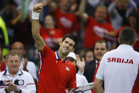 Serbia's Novak Djokovic celebrates winning a set against Czech Republic's Tomas Berdych during their Davis Cup World Group final tennis match in Belgrade November 17, 2013. REUTERS/Marko Djurica