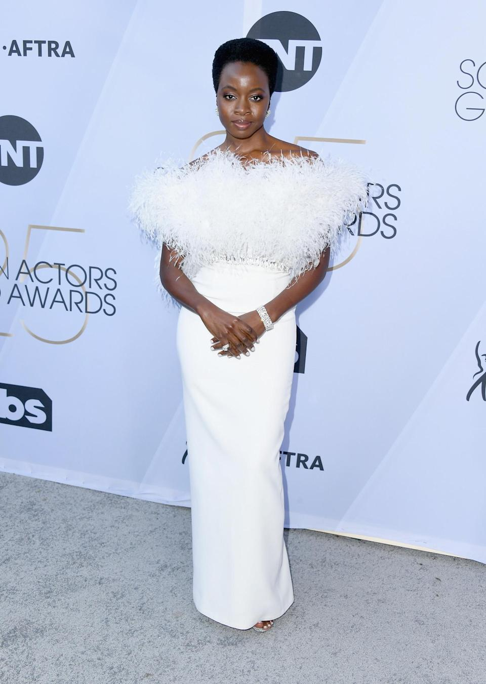 <p>Danai Gurira tickled in white feathers at the 2019 Screen Actors Guild Awards. (Photo: Getty Images) </p>