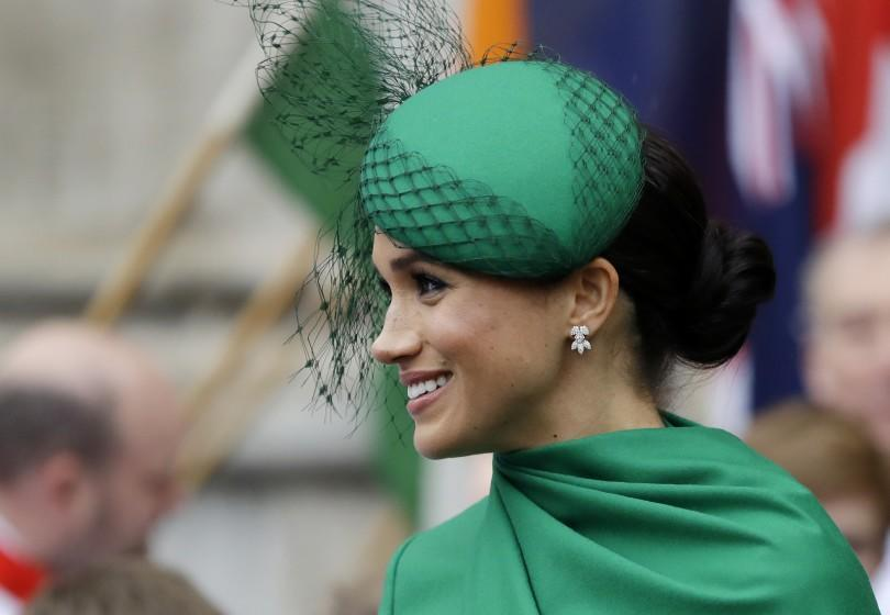 A woman wearing a green hat and dress