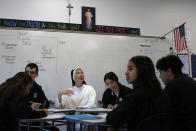 Sister Maris Stella Vaugham teaches a religion class at the St. John Paul II Catholic School in Phoenix, Ariz., on Feb. 26, 2020. In the western suburbs of Phoenix, enrollment is surging at this new Catholic high school built to serve a fast-growing, heavily Hispanic community. (AP Photo/Dario Lopez-MIlls)