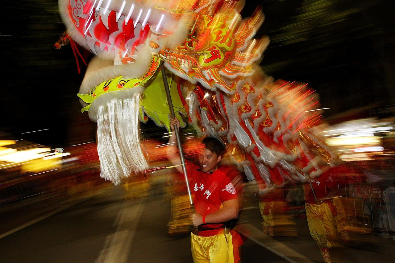 SYDNEY, AUSTRALIA - FEBRUARY 17:  Performers take part in the Chinese New Year Twilight Parade along George Street on February 17, 2013 in Sydney, Australia. More than 100,000 attended the annual parade to celebrate the Chinese Lunar New Year and more then 3,500 performers took part.  (Photo by Lisa Maree Williams/Getty Images)