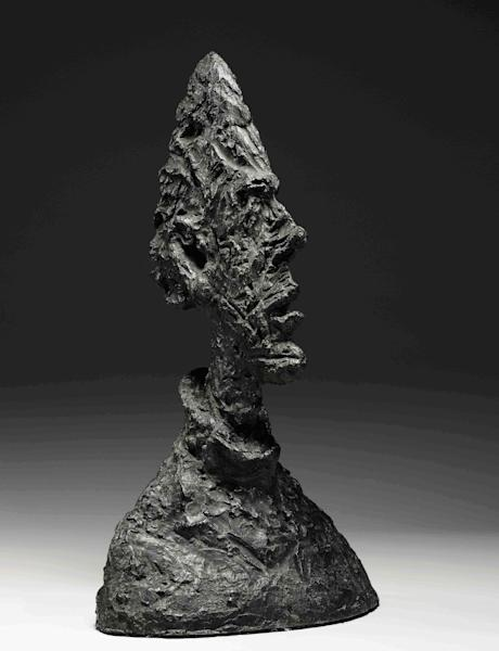 """This image provided by Sotheby's auction house, Monday, Nov. 4, 2013 is of sculptor Alberto Giacometti's, """"Large Thin Head (Large Head of Diego)."""" The work is scheduled for auction at Sotheby's on Nov. 13, 2013. (AP Photo/Sotheby's)"""