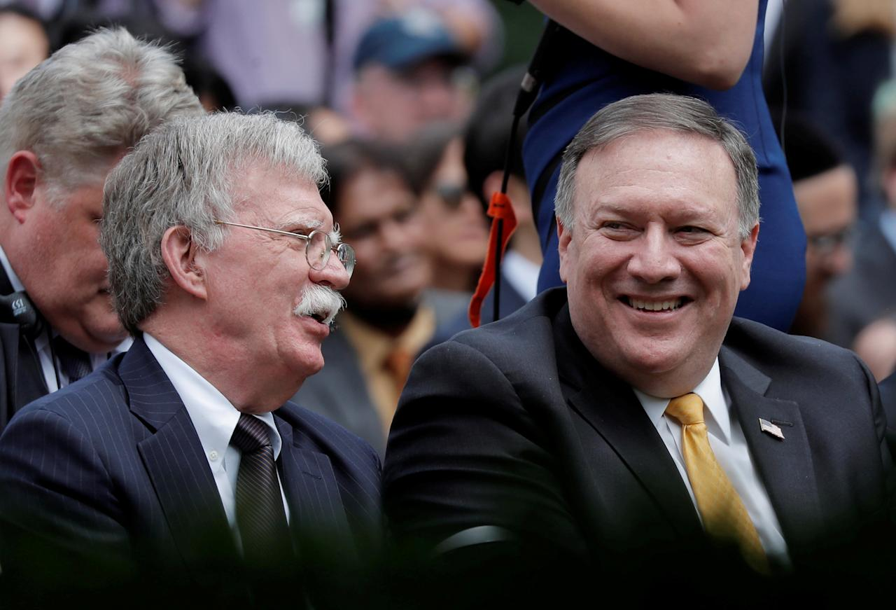 FILE PHOTO: U.S. Secretary of State Mike Pompeo and national security advisor John Bolton (L) attend a news conference in the Rose Garden of the White House in Washington, DC, U.S., June 7, 2018. REUTERS/Carlos Barria/File Photo