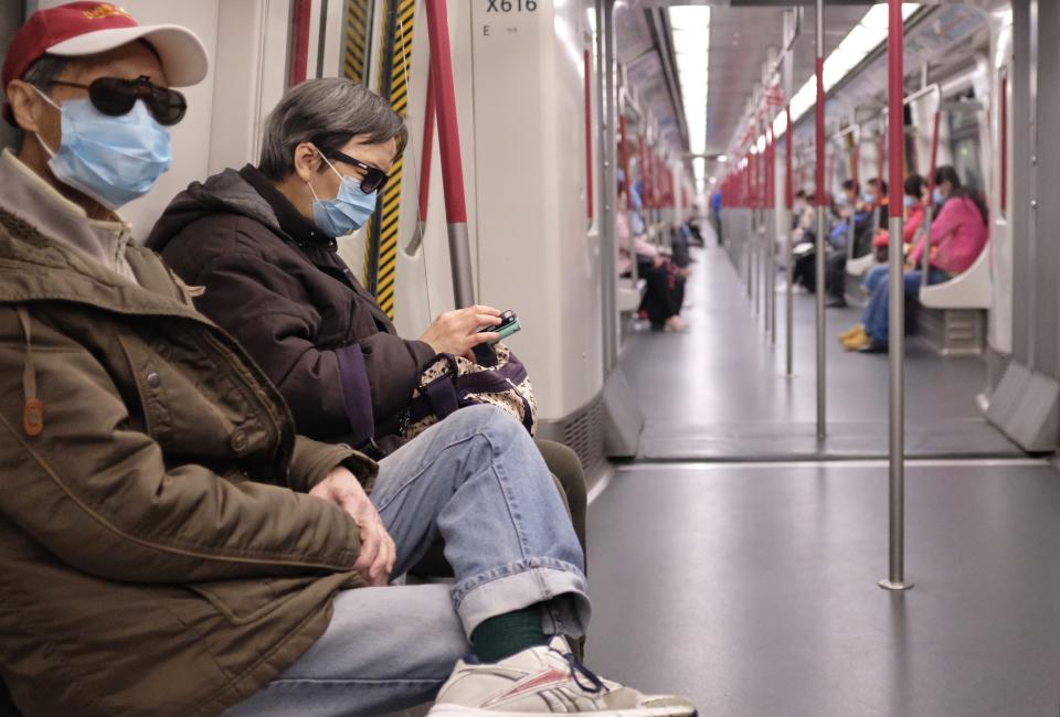 HONG KONG, CHINA, FEBRUARY 3, 2020: People wearing masks seen in the Mass Transit Railway (MTR). Hong Kong epidemic situation hit economic hard. The Financial Secretary Paul Chan said that Hong Kong may record a budget deficit this financial year.- PHOTOGRAPH BY May James / Echoes WIre/ Barcroft Media (Photo credit should read May James / Echoes Wire/Barcroft Media via Getty Images)