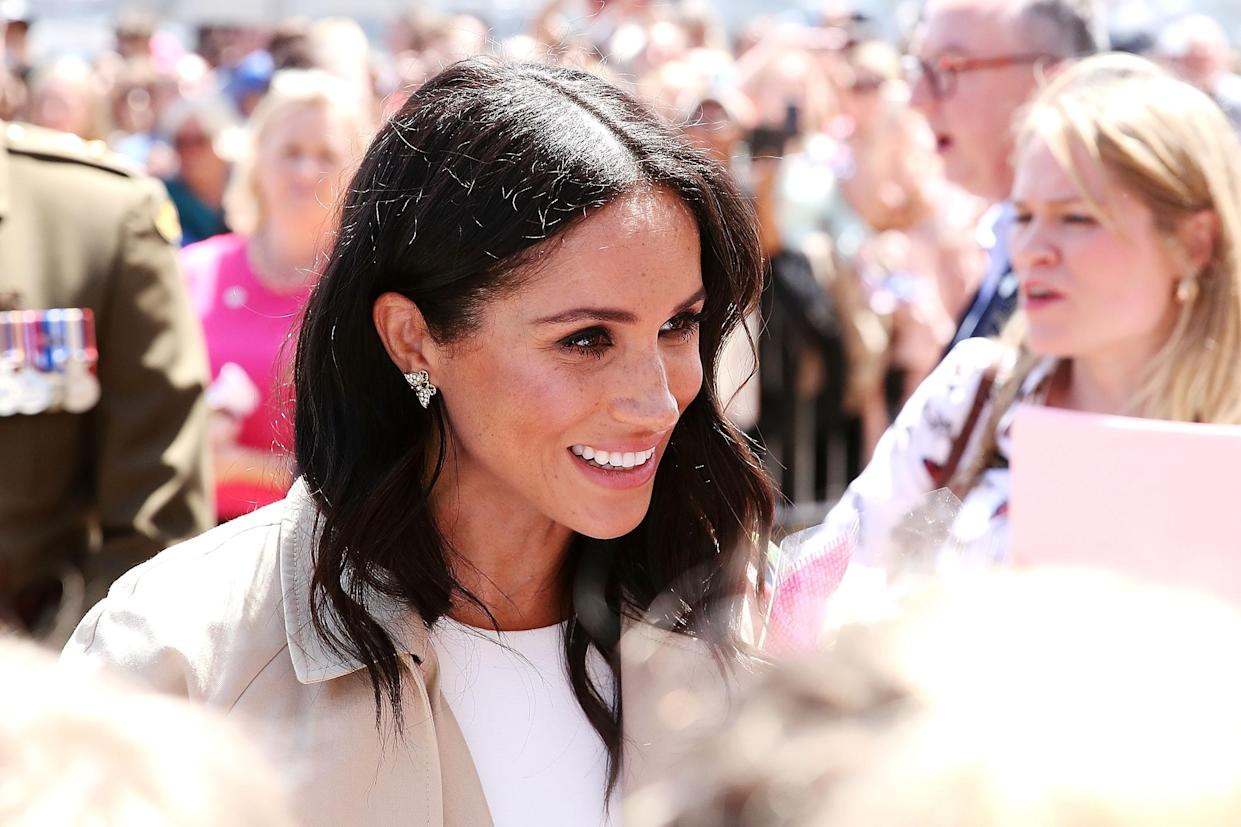 Meghan wore Diana's earrings during day one of the royal tour. Photo: Getty