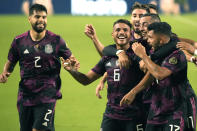 Mexico midfielder Jonathan Dos Santos (6) celebrates with teammates after scoring a goal against Honduras during the first half of a CONCACAF Gold Cup soccer match, Saturday, July 24, 2021, in Glendale, Ariz. (AP Photo/Rick Scuteri)
