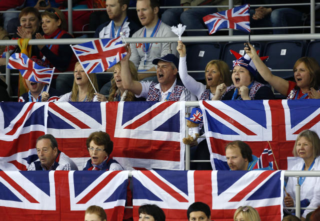 Fans cheer for Britain during their men's curling competition against Canada at the 2014 Winter Olympics, Saturday, Feb. 15, 2014, in Sochi, Russia. (AP Photo/Robert F. Bukaty)