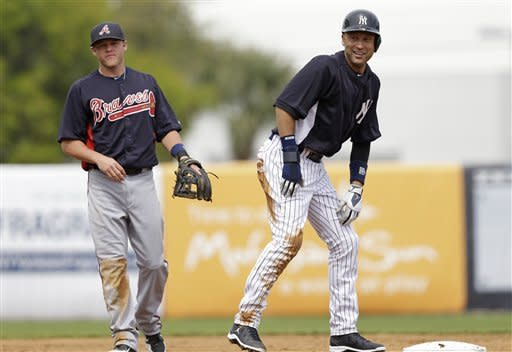 Atlanta Braves shortstop Tyler Pastornicky, left, looks on as New York Yankees Derek Jeter reacts after he was out at second base on a play during a spring training baseball game at Steinbrenner Field in Tampa, Fla., Saturday, March 9, 2013. (AP Photo/Kathy Willens)