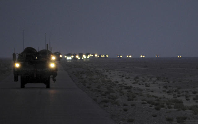 A line of Strykers convoy in the early hours of August 16, 2010 as part of the 4th Stryker Brigade Combat Team, 2nd Infantry Division, United States Division-Center?s last patrol through Iraq as they leave for Kuwait. Picture taken August 16, 2010. REUTERS/U.S. Army/Sgt. Kimberly Johnson/Handout (IRAQ - Tags: CONFLICT MILITARY POLITICS CIVIL UNREST) FOR EDITORIAL USE ONLY. NOT FOR SALE FOR MARKETING OR ADVERTISING CAMPAIGNS