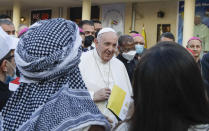 Pope Francis at the Chaldean Cathedral of Saint Joseph, in Baghdad, Iraq, Saturday, March 6, 2021. Earlier today Francis met privately with the country's revered Shiite leader, Grand Ayatollah Ali al-Sistani.(AP Photo/Andrew Medichini)