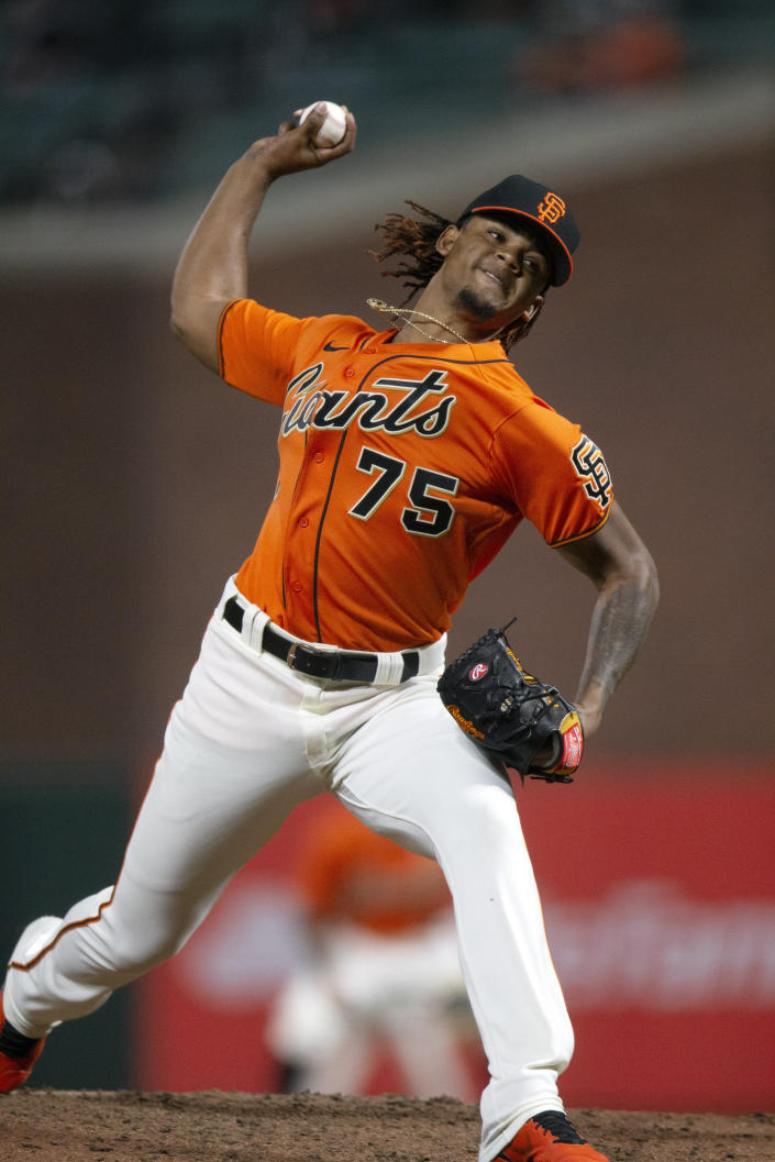 San Francisco Giants' Camilo Doval (75) delivers a pitch against the San Diego Padres during the seventh inning of a baseball game Friday, May 7, 2021, in San Francisco. (AP Photo/D. Ross Cameron)