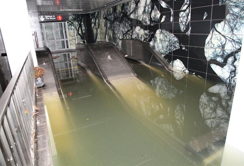 This Oct. 30, 2012, photo provided by New York's Metropolitan Transportation Authority (MTA) shows a flooded escalator in the South Ferry station of the No. 1 subway line, in lower Manhattan, after Superstorm Sandy passed through New York. Floodwaters that poured into New York's deepest subway tunnels may pose the biggest obstacle to the city's recovery from the worst natural disaster in the transit system's 108-year history but on Wednesday Gov. Andrew Cuomo announced limited subway service will resume on Thursday. (AP Photo/Metropolitan Transportation Authority)