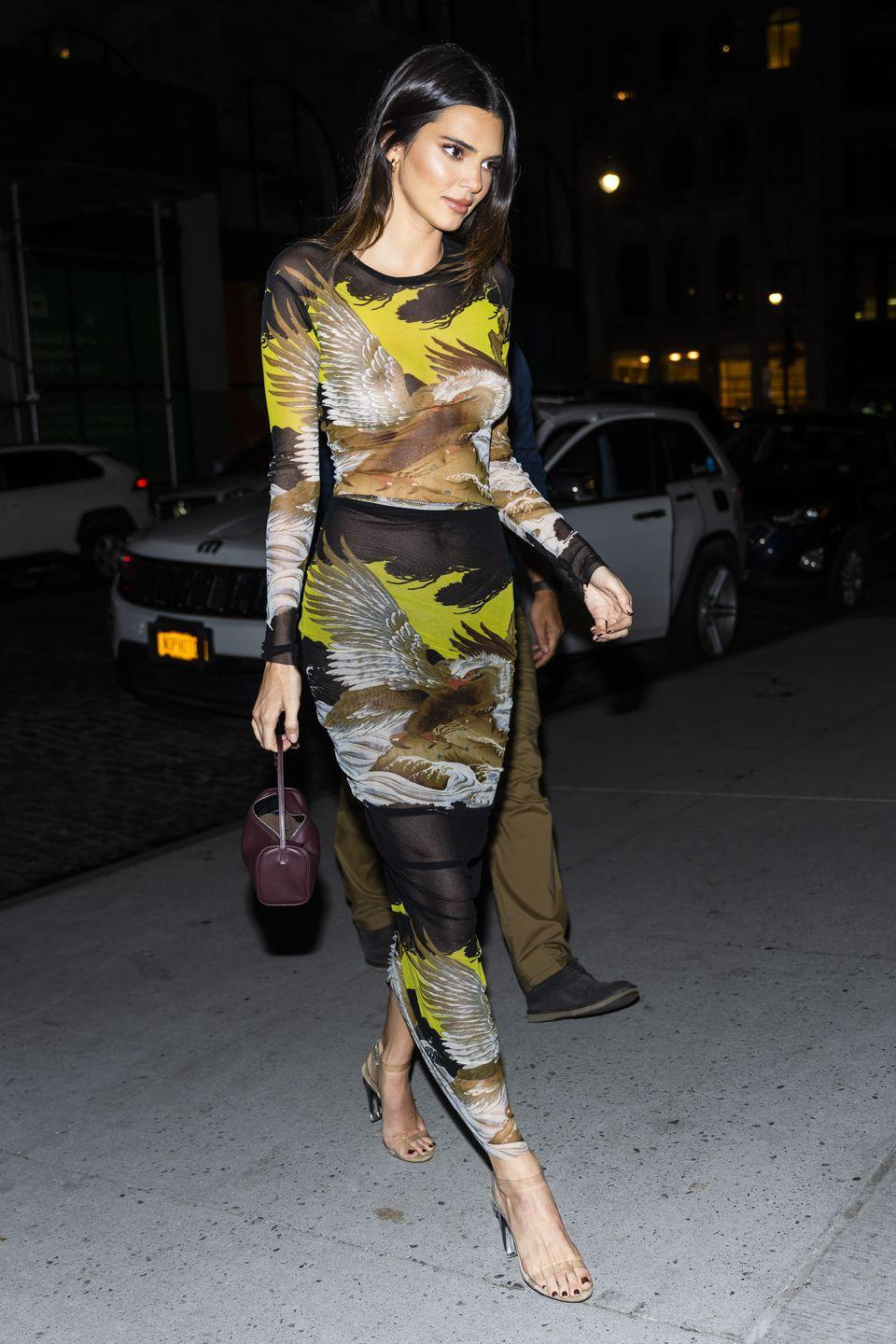 <p>The 25-year-old model wore a skin-tight vintage Jean Paul Gaultier dress for a 818 tequila part and dinner with her sister Kourtney Kardashian. </p><p>The 'Soleil' dress is from the 1990s and features an eagle and waves printed in black, brown and yellow tones. </p>