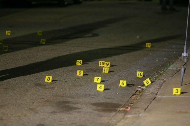 PHOTO: Evidence markers line the street outside a house after a shooting in Providence, Rhod Island, on May 13, 2021. (Stew Milne/AP)