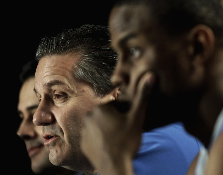 Kentucky head coach John Calipari, center, talks during a news conference, Saturday, March 24, 2012, in Atlanta. Kentucky is scheduled to play Baylor in the NCAA college basketball tournament South Regional finals on Sunday. (AP Photo/David J. Phillip)