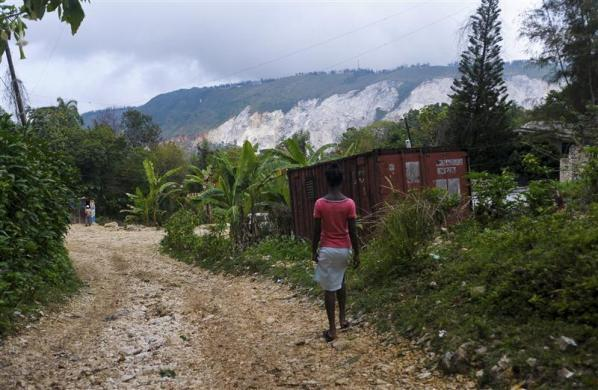 Haitian girl Fabien Destine, 14, who suffers from VSP congenital heart disease, or a hole in the chamber wall, walks to her home in Port-au-Prince, March 24, 2012.