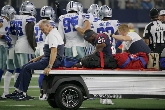 Houston Texans running back Lamar Miller (26) is carted off the field after suffering an unknown injury in the first half of a preseason NFL football game against the Dallas Cowboys in Arlington, Texas, Saturday, Aug. 24, 2019. (AP Photo/Michael Ainsworth)