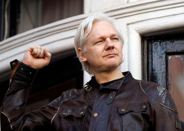 PHOTO: Julian Assange greets supporters outside the Ecuadorian embassy in London, May 19, 2017. (Frank Augstein/AP, FILE)