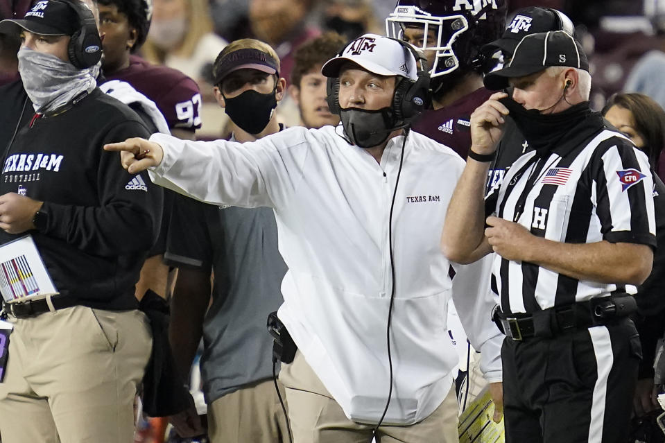 Texas A&M head coach Jimbo Fisher argues a call during the second half of an NCAA college football game against Arkansas Saturday, Oct. 31, 2020, in College Station, Texas. (AP Photo/Sam Craft)