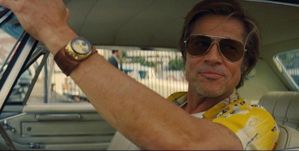 Cliff Booth (Brad Pitt) drives though Hollywood