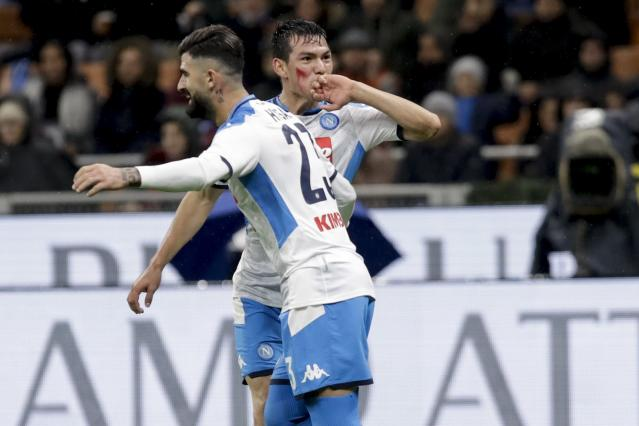 Napoli's Hirving Lozano, right, celebrates with Elseid Hysaj after scoring his side's opening goal during the Serie A soccer match between AC Milan and Napoli, at the San Siro stadium in Milan, Italy, Saturday, Nov. 23, 2019. (AP Photo/Luca Bruno)
