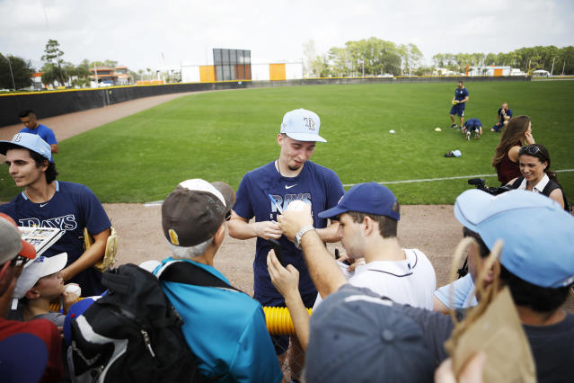 Tampa Bay Rays pitcher Blake Snell signs autographs for fans during spring baseball practice Thursday, Feb. 13, 2020 in Port Charlotte, Fla. (Octavio Jones/Tampa Bay Times via AP)