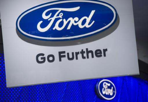 Ford lowers profit forecast as US auto boom ebbs