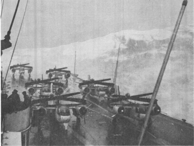 HMCS Bonaventure in the midst of a storm in December, 1959. Six DeHavilland -Grumman C2SF-1 Trackers are seen strapped to the deck. With winds gusting to 166 kilometres per hour, Bryce Allen says the ship probably should have sunk.