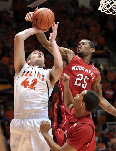 Illinois forward Tyler Griffey (42) has his shot blocked by Nebraska guard Caleb Walker (25) during the first half of an NCAA college basketball game at Assembly Hall in Champaign, Ill., Saturday, Jan. 7, 2012. (AP Photo/John Dixon)