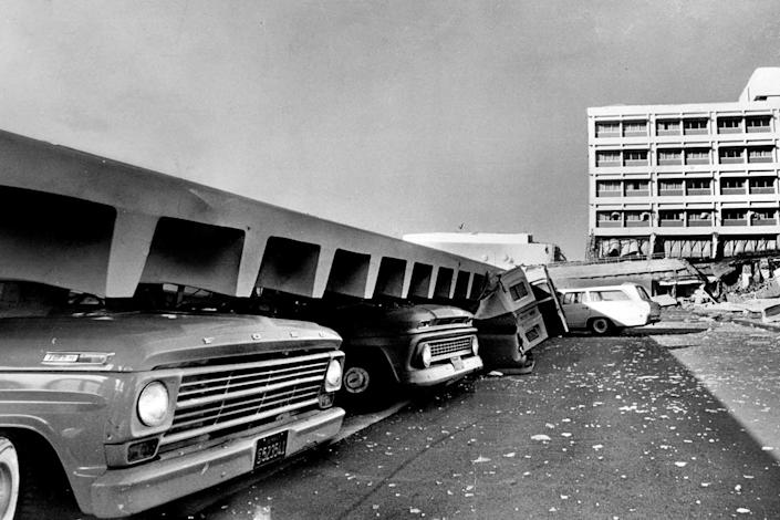Automobiles crushed by falling debris brought on by an earthquake