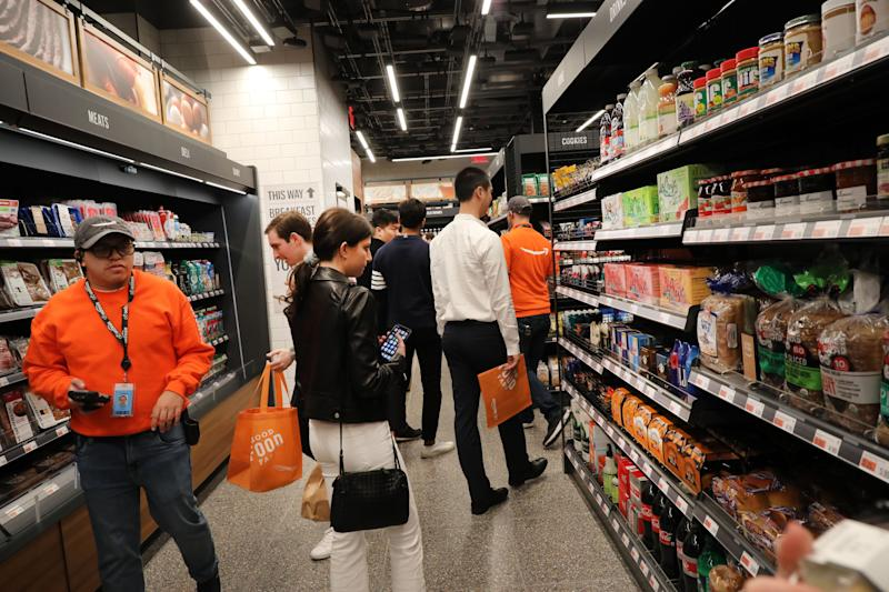 NEW YORK, NEW YORK - MAY 07: People shop at the newly opened Amazon Go Store on May 07, 2019 in New York City. The cashier-less store, the first of this type of store, called Amazon Go, accepts cash and is the 12th such store in the United States located at Brookfield Place in downtown New York. The roughly 1,300-square-foot store sells a variety of food items, prepared meals and Amazon's own meal kits. It is believed that by 2021 Amazon is considering opening up as many as 3,000 of its cashier-free stores across the United States. (Photo by Spencer Platt/Getty Images)