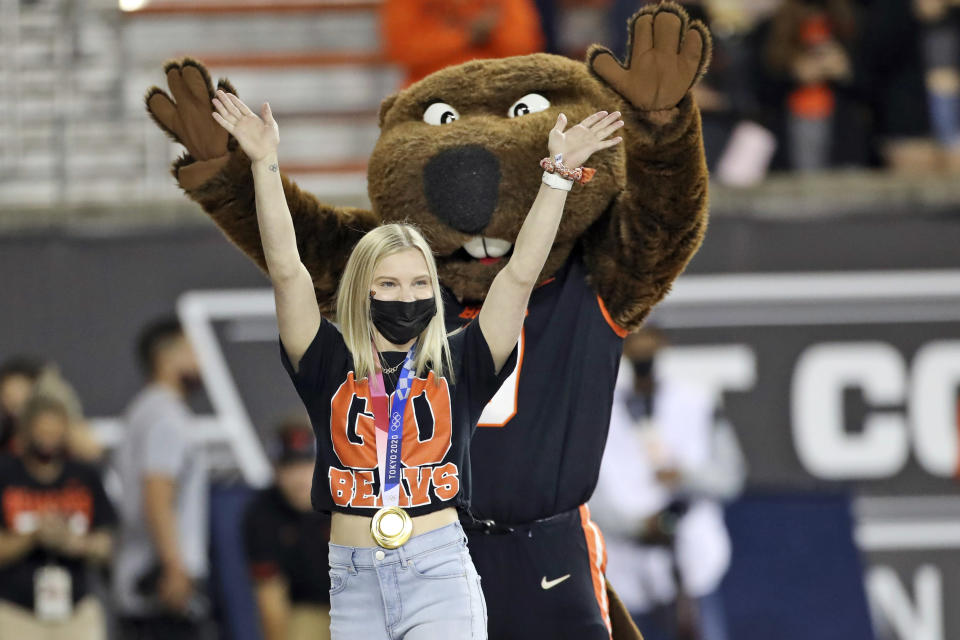 FILE - In this Saturday, Sept. 11, 2021, file photo, U.S. Olympic gold medal gymnast and incoming Oregon State student Jade Carey waves to the crowd during a timeout in the first half of an NCAA college football game between Oregon State and Hawaii in Corvallis, Ore. Carey is finally embarking on her freshman year at Oregon State, after taking a somewhat winding route to Corvallis. Then again, the 21-year-old Olympic gold medalist is used to taking the non-traditional path. (AP Photo/Amanda Loman, File)